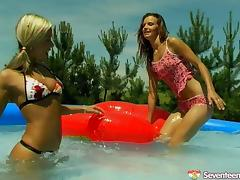 Lesbian cutie has her coochie throbbed with a toy at the pool
