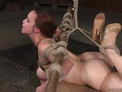 Bella Rossi is now totally tied up and has to suck the erected dicks