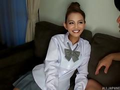 Japanese chick with pretty eyes gets her face decorated with man-juice