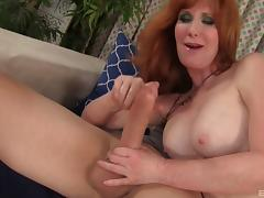 Mature redhead minx Freya enjoys being slammed with a fat cock