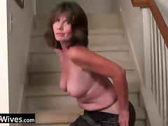 Hot and horny mature lady is masturbating on the stairway