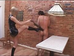 Fine blonde with natural tits spanking her slave mercilessly in BDSM porn