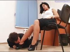 Boss lady femdom brunette having her foot licked by slave in office