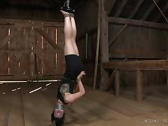Brunette slave widened legs when tortured in BDSM shoot