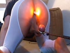Burning candle in asshole