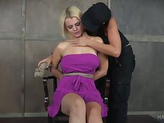 Lady in a purple dress treated like a bad girl that she is