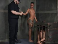 Ebony babe hangs upside down during a great torture game