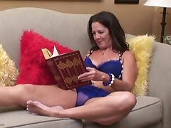 Randy mature brunette reads a book and drills her gaping cunt