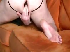 Fucking a huge brown dildo on the couch