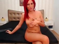 Sexy red hair babe stripping and teasing with her hot body on webcam