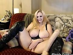 Blonde with large breasts places inside her vagina specific