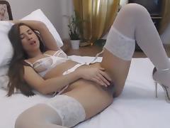 Hot college babe in white lingerie masturbating