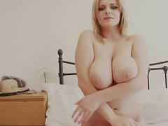 Curvy young blonde takes seductive poses naked in bed