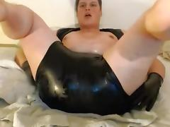 Shiny latex masturbation