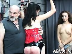 Woman endures heavy stimulation in wild fetish episode scene