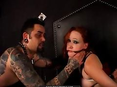 Tattooed guy ties up a sexy redhead