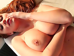 Cute redhead soaks up the sunlight