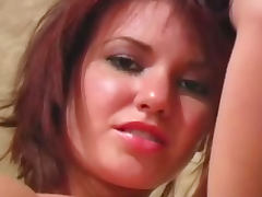 Amateur redhead rubs her pussy in nylons