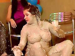 Big tits girl is hot mud wrestling