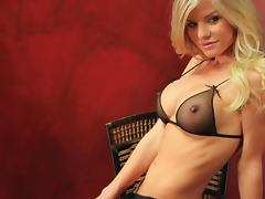 Pretty Lindsey Knight fondles her tits sitting in an armchair