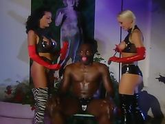 Two hot sadomaso babes are torturing this poor black guy