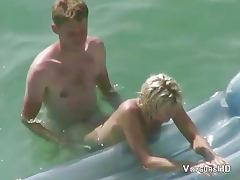 Voyeur films couple fucking in the water