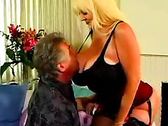 Gigantic tits of a fucked slut in a corset