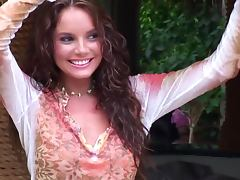 Curly haired cutie Hillary Fisher poses nude in the garden