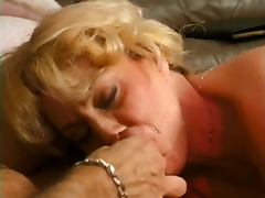 Round ass MILF gobbles young stud on sofa