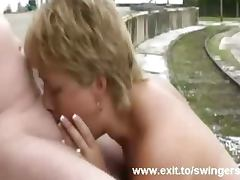 Swinger mom Tracey sucking stranger outdoors