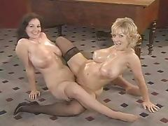 Retro video with busty blonde and brunette having lesbian sex