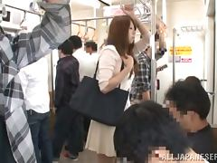 Pretty Japanese girl gets her pussy fingered in a bus