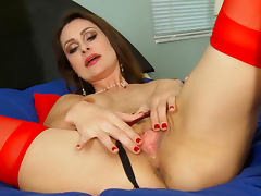 Brunette Nora Noir is poking her shaved hole with fingers