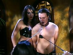 A pair of fetish dolls dominate a dude for being a player