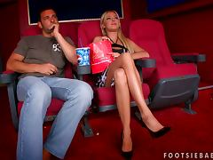 Foot fetish at the movies for a kinky couple