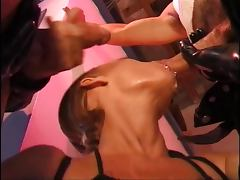 Horny blonde in latex sucks and takes two cocks next to vending machine