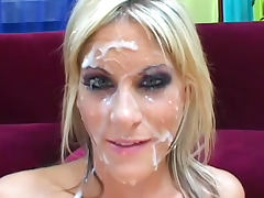 Sexy blonde with cute face is getting covered with sperm