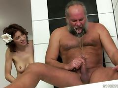 Brigitta gets fucked by an old dude in the bathroom porn video
