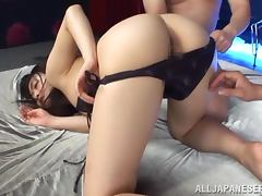 Sae Aihara sucks two pricks and takes them in her bushy cunt
