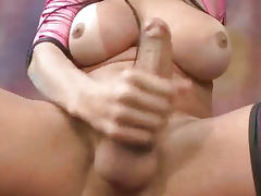 Busty latina shemale babe tugging on her hard cock