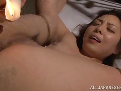 Japanese girl gets her body covered with hot wax in lesbian action