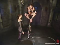 Claire Adams gets tied up and then toyed with big dildo