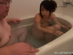 Petite Hikari Matsush gives a blowjob to fat guy