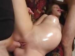 Pregnant slut satisfies two men and gets cum on her nice natural tits