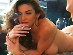 Slender brunette smokes a cigarette