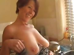 Sexy MILF Shows Off In The Kitchen