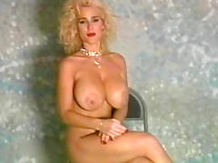 Curly-haired blonde milf is masturbating