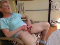 Granny is sitting and masturbating in a solo clip