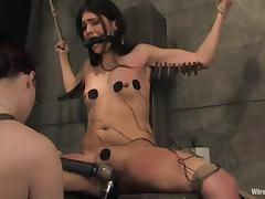 Jade Indica enjoys having clothes pegs and wires all over her body