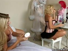 Two blondes in sexy dresses toy pussies in close-up scenes